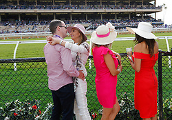 November 3, 2017 - San Diego, California, U.S. - PAUL PHILLIPS, left, MAIA IANEVA, IVETTE VINITES and SAMANATHA RAYAS watch the Breeders' Cup at the Del Mar Thoroughbred Club on Friday. (Credit Image: © K.C. Alfred/San Diego Union-Tribune via ZUMA Wire)