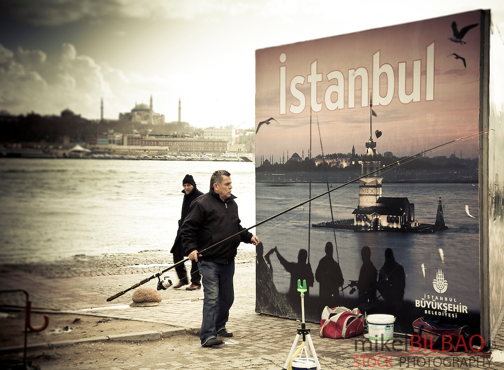 Cityscape and angler.<br /> Istanbul, Turkey.