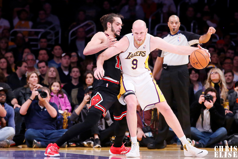 09 February 2014: Los Angeles Lakers center Chris Kaman (9) posts up Chicago Bulls center Joakim Noah (13) during the Chicago Bulls 92-86 victory over the Los Angeles Lakers at the Staples Center, Los Angeles, California, USA.