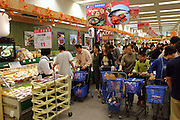During their expedition to Ito Yokado, a Japanese supermarket chain, the Dongs (at left) of Beijing, China, inspect fish and sushi rolls. In many restaurants and markets in China, much of the seafood is sold live as a guarantee of freshness. (Supporting image from the project Hungry Planet: What the World Eats). The Dong family of Beijing, China, is one of the thirty families featured, with a weeks' worth of food, in the book Hungry Planet: What the World Eats.