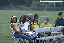 Family, friends, students, district employees and residents gather at a vigil to honor the lives of Janiya Castleberry and Allison McGillis, at Helen Fort Newcomb Middle School in Pemberton, NJ, on Thursday. (Bastiaan Slabbers/for PhillyVoice) teacher Ms. Kerner in background