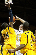 26 January 2010:  Kent State's Justin Greene (34), Toledo's Jordan Dressler (42) and Kent State's Chris Singletary (2) during the NCAA basketball game between Kent State and the Toledo Rockets at Savage Arena in Toledo, OH.