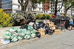 "© Licensed to London News Pictures. 22/04/2019. LONDON, UK. Piles of rubbish awaiting collection next to activists gathered at Marble Arch during ""London: International Rebellion"", on day eight of a protest organised by Extinction Rebellion.  Protesters are demanding that governments take action against climate change.  After police issued section 14 orders at the other protest sites of Oxford Circus, Waterloo Bridge and Parliament Square resulting in over 900 arrests, protesters have convened at the designated site of Marble Arch so that the protest can continue.  Photo credit: Stephen Chung/LNP"