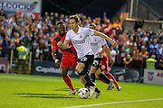 Josh Morris & David Tutonga during the Capital One Cup match between York City and Bradford City at Bootham Crescent, York, England on 11 August 2015. Photo by Simon Davies.