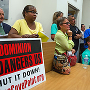 WALDORF, MD - AUG20: Citizens listen to public comments regarding the proposed gas-fired power plant made to the Maryland Public Service Commission, August 20, 2015, at the Charles County Public Library in Waldorf, Maryland. The plant would become the fifth plant in a 13-mile radius in southern Maryland and drew a standing room only crowd to comment on the record. (Photo by Evelyn Hockstein/For The Washington Post)