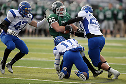 15 November 2014:  Brady Hails triple teamed by Ryan Boswell, P. Pendleton, andNick French during an NCAA division 3 football game between the North Park Vikingsand the Illinois Wesleyan Titans in Tucci Stadium on Wilder Field, Bloomington IL