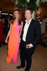 HEATHER KERZNER and HUGH GRANT at the Masterpiece Midsummer Party in aid of Marie Curie Cancer Care held at The Royal Hospital Chelsea, London on 2nd July 2013.