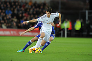 Nelson Oliveira of Swansea city breaks away from Chelsea's Nemanja Matic. Barclays Premier League match, Swansea city v Chelsea at the Liberty Stadium in Swansea, South Wales on Saturday 17th Jan 2015.<br /> pic by Andrew Orchard, Andrew Orchard sports photography.