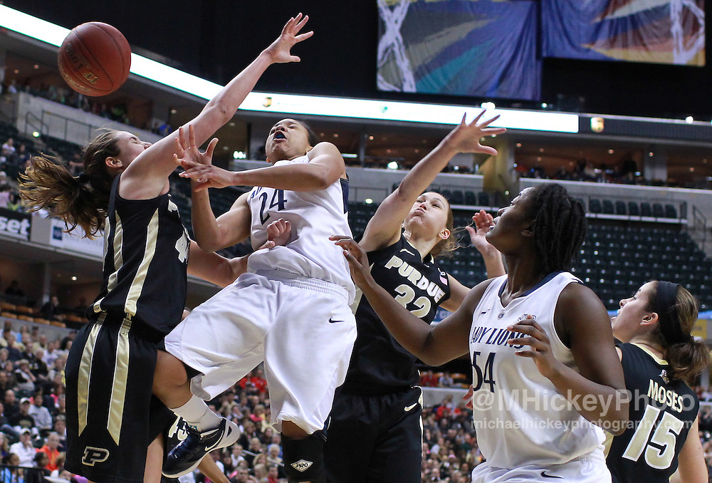 March 03, 2012; Indianapolis, IN, USA; Penn State Lady Lions forward Mia Nickson (24) loses the ball during a shot attempt as Purdue Boilermakers center Chelsea Jones (40) and Purdue Boilermakers guard/forward Sam Ostarello (32) defends during the semifinals of the 2012 Big Ten Tournament at Bankers Life Fieldhouse. Purdue defeated Penn State 68-66. Mandatory credit: Michael Hickey-US PRESSWIRE
