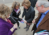 Neighborhood leader and Task Force member Sue Wesely (from left) and City Council members Ann Poe, Monica Vernon, and Scott Olson look over property maps outside the old Boys and Girls Club location as members of the Northwest Recreation Center Task Force take a bus tour of the five possible sites for a new recreation center in Cedar Rapids on Thursday morning, February 23, 2012. (Stephen Mally/Freelance)