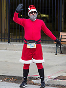 28 NOVEMBER 2019 - DES MOINES, IOWA: JEFF HANSEN, originally from Des Moines, now living in Chicago, stretches before the annual Turkey Trot. He dressed as Santa to run the race. The Turkey Trot is a Des Moines Thanksgiving 5 mile fun run.           PHOTO BY JACK KURTZ