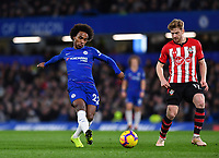 Football - 2018 / 2019 Premier League - Chelsea vs Southampton<br /> <br /> Chelsea's Willian holds off the challenge from Southampton's Stuart Armstrong at Stamford Bridge.<br /> <br /> COLORSPORT/ASHLEY WESTERN
