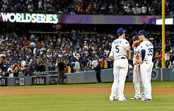 October 31, 2017 - Los Angeles, California, U.S. - Los Angeles Dodgers' from left to right, Corey Seager, Logan Forsythe, Justin Turner, and Cody Bellinger talk as relief pitcher Brandon Morrow (not pictured) warms up in the 5th inning of game six of a World Series baseball game at Dodger Stadium on Tuesday, Oct. 31, 2017 in Los Angeles. (Photo by Keith Birmingham, Pasadena Star-News/SCNG) (Credit Image: © San Gabriel Valley Tribune via ZUMA Wire)