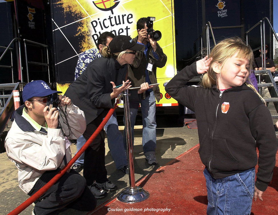 Wannabe celebrity Tiffany Wilson, 6, strikes a pose as she is hounded by faux paparazzi on the red carpet before entering the Kodak Picture Planet experience in Santa Monica, Calif.. The Kodak Picture Planet experience is a 53-foot long interactive exhibit that travels the country to teach people how to take, make and share better pictures. Photo/Kodak, Susan Goldman.