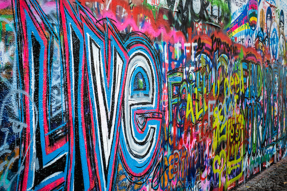 Colourful Graffiti cover John Lennon wall in Prague