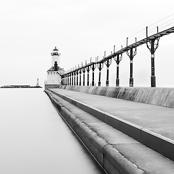 Panorama of Michigan City lighthouse black and white picture. The Michigan City East Pierhead Lighthouse is located in Michigan City, Indiana along the Lake Michigan shoreline.
