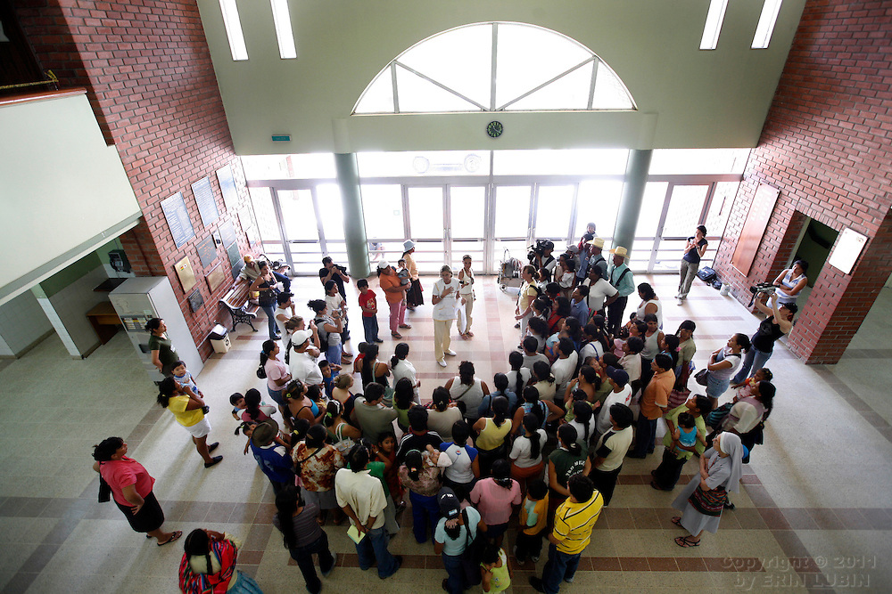 A crowd gathers where the surgery schedule is being posted by the Operation Smile team at Hospital Japones in Santa Cruz, Bolivia on Saturday, November 10, 2007, during Operation Smile's World Journey of Smiles. Surgeries begin on November 12, 2007...Photograph by Erin Lubin