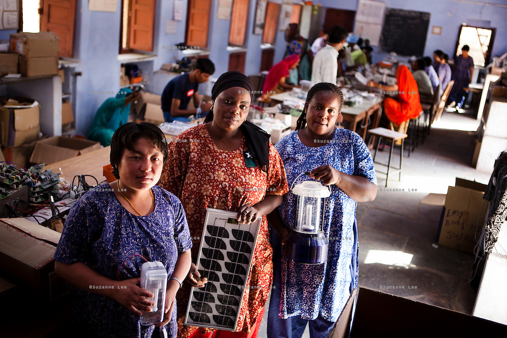 (L-R) International students of the Barefoot Solar Engineering class, Kingzing Chodon (aged 30) from Lour, Bhutan; Precious Molobane Mamogale, aged 42, from Fetakgomo, Lompopo, South Africa; and Matildah Chikwata (aged 43) from Chibaya, Mashonaland West, Zimbabwe, pose for a group portrait in class. They are all students in a 6 month course in solar engineering in the Barefoot College in Tilonia village, Ajmer, Rajasthan, India. Photo by Suzanne Lee for Panos London