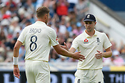 Stuart Broad of England is congraulated by Chris Woakes of England after taking his 450th test match wicket with the dismissal of David Warner of Australia during the International Test Match 2019 match between England and Australia at Edgbaston, Birmingham, United Kingdom on 3 August 2019.
