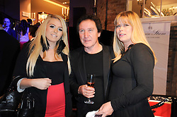 Left to right, CASEY JONES, KENNEY JONES and his wife JAYNE JONES at a party to celebrate the launch of Armin Storm's One Week Watch at Asprey, 167 New Bond Street, London W1 on 18th November 2010.
