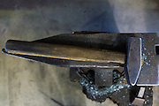 A blacksmith anvil and sledgehammer at a iron working shop in Charleston, SC