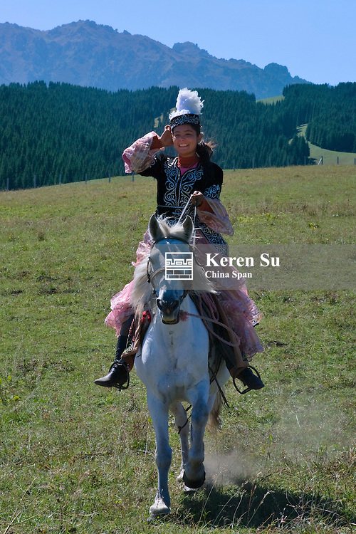 Kazakh girl on horseback, Mt. Tianshan, Xinjiang Province, Silk Road, China