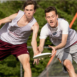 Lisa Johnston | lisajohnston@archstl.org | Twitter: @aeternusphoto<br /> Offenseman Eric Bracken tried to grab the frisbee from between defensman Alex Trunko's hands. The two are both seniors at the school. <br /> DeSmet Jesuit High School's Ultimate Frisbee team is have won eight championships in a row and are in the middle of another winning season.