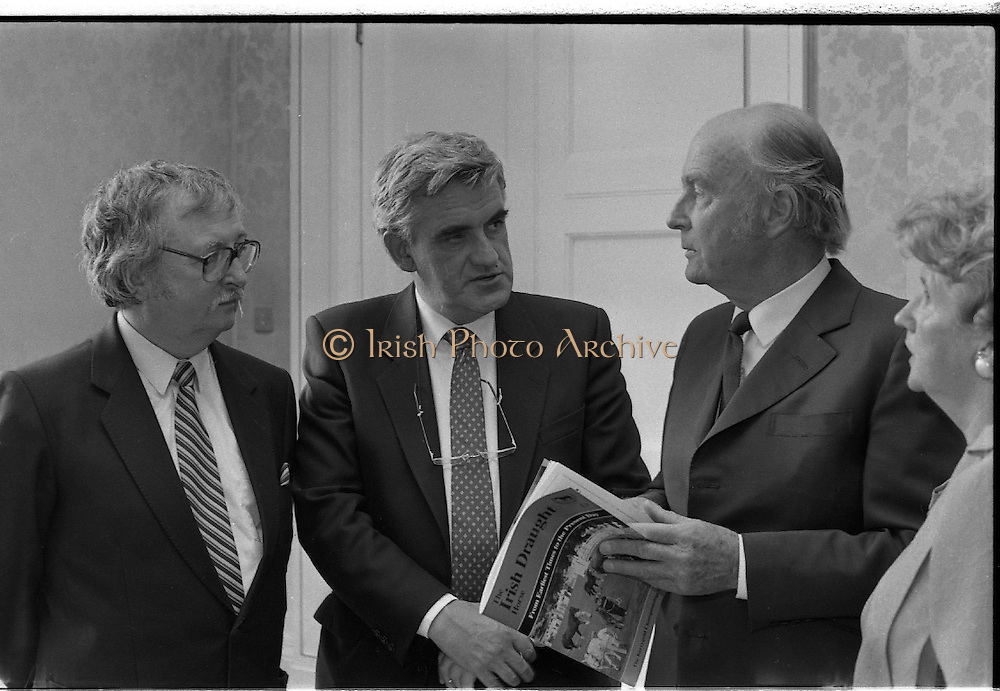 """Draught Horse Publication Presented To President Hillery. (T3)..1989..05.07.1989..07.05.1989..5th July 1989..President Hillery was presented with the first copy of the new publication, """"The Irish Draught Horse"""", by the Irish Draught Horse Society..Among those at the presentation were the books author Mr Michael Slavin (L) and mr Fintan Flannelly, National Chairman, Irish Draught Horse Society..The event was photographed at Aras an Uachtarain, Phoenix Park, Dublin."""