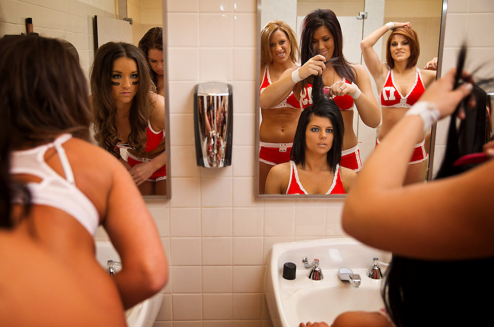 From left, Lindsay Burnham, Linsey Noble, SarahJane Thompson, Morgan Anderson, Nikki Koley and Ally Allen fix makeup and hair before the team's opening game against the Atlanta Steam in Gwinnett, Ga., on Saturday, April 13, 2013. The away team travels to the arena on game day and participates in photo and video shoots all day until the game that evening. &quot;We had to be a the airport, makeup and hair ready at 4:30 a.m.,&quot; Noble said. &quot;We were on our feet all day.&quot;<br /> <br /> ---<br /> <br /> The Lingerie Football League (now the Legends Football League) players say that they are athletes first. The lingerie is, in their minds, an unfortunate necessity. Many admitted that sex appeal was the reason fans attended the game, but talk to any woman who&rsquo;s played, and you&rsquo;ll learn that it&rsquo;s no powder puff or flag football. <br /> <br /> The players dedicate exhaustive effort, months of their time and thousands of dollars to a sport with little reward, to a league that takes more than it gives. Many players hope that one day the league won&rsquo;t be about the sex appeal but instead a showcase for female athleticism.<br /> <br /> &ldquo;People can get the impression it&rsquo;s just a bunch of bimbos out here,&rdquo; Omaha Heart quarterback Linsey Noble said. &ldquo;Everyone has their own story. You can&rsquo;t really judge people by the cover, by the book or the lingerie.&rdquo;<br /> <br /> <br /> Chicago Freelance Photographer | Alyssa Schukar | Photojournalist