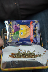 Rolling a joint using tobacco and Happy Joker, a legal high that has a similar effect to cannabis