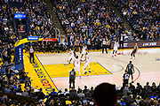 Golden State Warriors guard Stephen Curry (30) scores a three pointer against the LA Clippers at Oracle Arena in Oakland, California, on February 22, 2018. (Stan Olszewski/Special to S.F. Examiner)