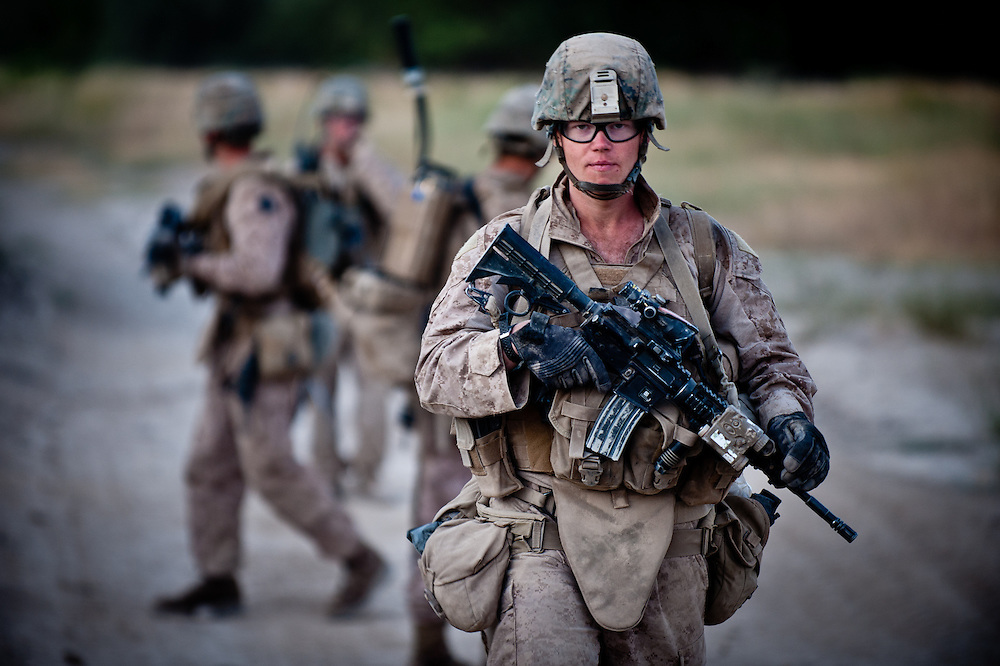 Hospitalman Matthew Foreit, from Stone Park, Illinois, walks on patrol in Sangin District, near Patrol Base Fires, in July 2011. Foreit lost a leg to an IED several weeks after this picture was taken.