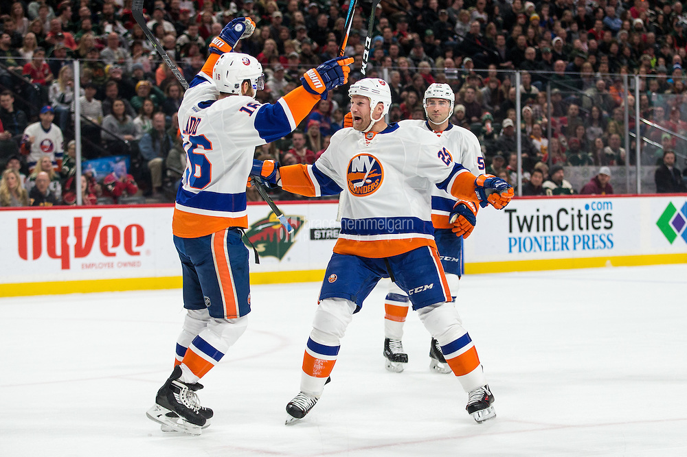 Dec 29, 2016; Saint Paul, MN, USA; New York Islanders forward Jason Chimera (25) celebrates his goal with forward Andrew Ladd (16) during the first period against the Minnesota Wild at Xcel Energy Center. Mandatory Credit: Brace Hemmelgarn-USA TODAY Sports