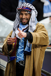 A Man City supporter in Arabic dress smailes before the match - Photo mandatory by-line: Rogan Thomson/JMP - Tel: 07966 386802 - 18/02/2014 - SPORT - FOOTBALL - Etihad Stadium, Manchester - Manchester City v Barcelona - UEFA Champions League, Round of 16, First leg.