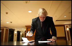 Mayor of London Boris Johnson makes last minute adjustments to his speech to the England Cricketers Mumbai, Wednesday November 28, 2012. Photo by Andrew Parsons / i-Images