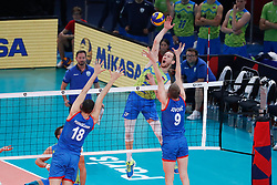 PARIS, FRANCE - SEPTEMBER 29: Tine Urnaut #17 of Slovenia spikes the ball against Marko Podrascanin #18 and Nikola Jovovic #9 of Serbia during the EuroVolley 2019 Final match between Serbia and Slovenia at AccorHotels Arena on September 29, 2019 in Paris, France. Photo by Catherine Steenkeste / Sipa / Sportida