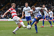 Bury Defender, Peter Clarke and Doncaster Rovers On loan Midfielder, Gary McSheffrey battle for the ball during the Sky Bet League 1 match between Bury and Doncaster Rovers at the JD Stadium, Bury, England on 9 April 2016. Photo by Mark Pollitt.