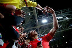 England's Jesse Lingard takes a selfie with fans after winning the FIFA World Cup 2018, round of 16 match at the Spartak Stadium, Moscow.