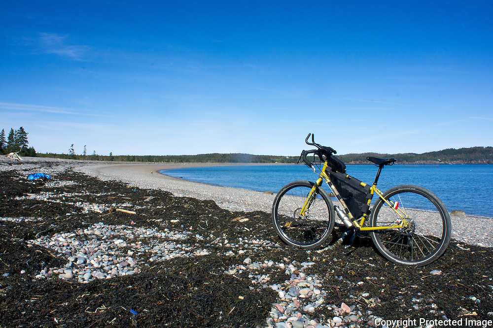 Coastal cycling the old carriage trails on Campobello leads to a beautiful ocean front beach on the Bay of Fundy