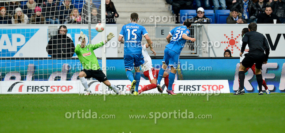 02.02.2013, Rhein Neckar Arena, Sinsheim, GER, 1. FBL, TSG 1899 Hoffenheim vs SC Freiburg, 20. Runde, im Bild Kevin VOLLAND TSG 1899 Hoffenheim erzielt das 2:1 (Rvºckennummer 31) gegen Torwart Oliver BAUMANN SC Freiburg TOR, rechts Schiedsrichter Robert HARTMANN // during the German Bundesliga 20th round match between TSG 1899 Hoffenheim and SC Freiburg at the Rhein Neckar Arena, Sinsheim, Germany on 2013/02/02,, , , , . EXPA Pictures © 2013, PhotoCredit: EXPA/ Eibner/ Weber..***** ATTENTION - OUT OF GER *****