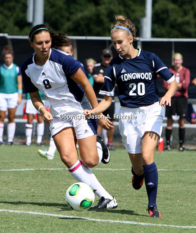 UNCW's Morgan Leyble battles Longwood's Amanda Spencer for the ball.