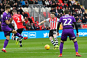Jake Taylor (25) of Exeter City shoots at goal during the EFL Sky Bet League 2 match between Exeter City and Grimsby Town FC at St James' Park, Exeter, England on 29 December 2018.