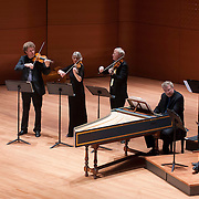 May 1, 2012 - New York, NY :  From left, flautist Karl Kaiser, violinist and director Gottfried von der Goltz, violinist Beatrix Hülsemann, violist Christian Goosses, harpsichordist Torsten Johann, and cellist Guido Larisch of the Freiburg Baroque Orchestra perform Johann Sebastian Bach's Orchestra Suite No. 2 in B minor (c. 1738-39) as part of Lincoln Center's 2011/2012 Great Performers Season at Alice Tully Hall on Tuesday night. CREDIT : Karsten Moran for The New York Times