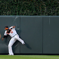 29 June 2009:  Baltimore Orioles center fielder Adam Jones (10) makes a leaping catch at the wall to rob Boston Red Sox third baseman Kevin Youkilis of a home run in the 4th inning at Camden Yards in Baltimore, MD.  The Red Sox defeated the Orioles 4-0.  ****For Editorial Use Only****