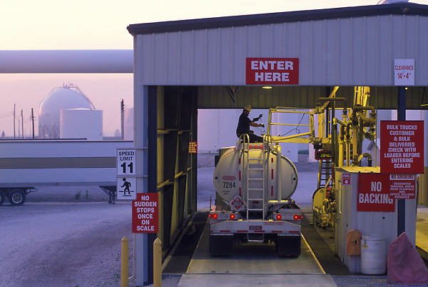 Weighing a large liquid transport truck under a garage