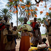 April 28, 2012 - Buram, Nuba Mountains, South Kordofan, Sudan: A group of Nuba people rests under the shade of a tree before continue the three to four day journey to a refugee camp in the neighbour South Sudan. Thousands of people have in the past months fled the bombardments and hunger in South Kordofan. Since the 6th of June 2011, the Sudan's Army Forces (SAF) initiated, under direct orders from President Bashir, an attack campaign against civil areas throughout the South Kordofan's province. Hundreds have been killed and many more injured...Local residents, of Nuba origin, have since lived in fear and the majority moved from their homes to caves in the nearby mountains. Others chose to find refuge in South Sudan, driven by the lack of food cause by the agriculture production halt due to the constant bombardments of rural areas.