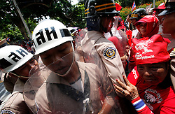 A Thai red shirt protester tries to push past a riot navy officer as they march towards the ASEAN summit venue of the Pattaya Exhibition and Convention Hall (PEACH) demanding the current government step down, on the first day of the Association of South East Asian Nations (ASEAN) plus six summit, in Pattaya, Thailand, about 160 km south east of Bangkok, Thailand, 10 April 2009. Thailand hosts the ASEAN plus three and six summits including leaders of China, Japan, South Korea, India, Australia, and New Zealand, with South East Asian leaders, from April 10 to 12.