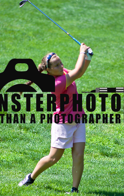 06/30/11 Newark DE: Golfer Maddie Silverman(17) hits the ball towards hole 12 during round two of the DSGA and DWGA junior golf championships Thursday, June 30, 2011 at Newark Country Club in Newark Delaware.