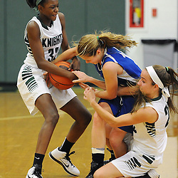TOM KELLY IV &mdash; DAILY TIMES<br /> DCS's Siani McNeil (32) and Paige Thompson (25) fights for possession of the ball with Christian Academy's Lindsay Haseltine (10) during the, The Christian Academy at Delaware County Christian School girls basketball game on Friday afternoon, December 12, 2014.