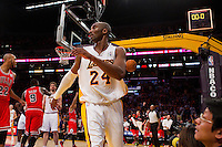 25 December 2011: Guard Kobe Bryant of the Los Angeles Lakers walks off the court as the Chicago Bulls celebrate after defeating the Lakers 88-87 at the STAPLES Center in Los Angeles, CA.